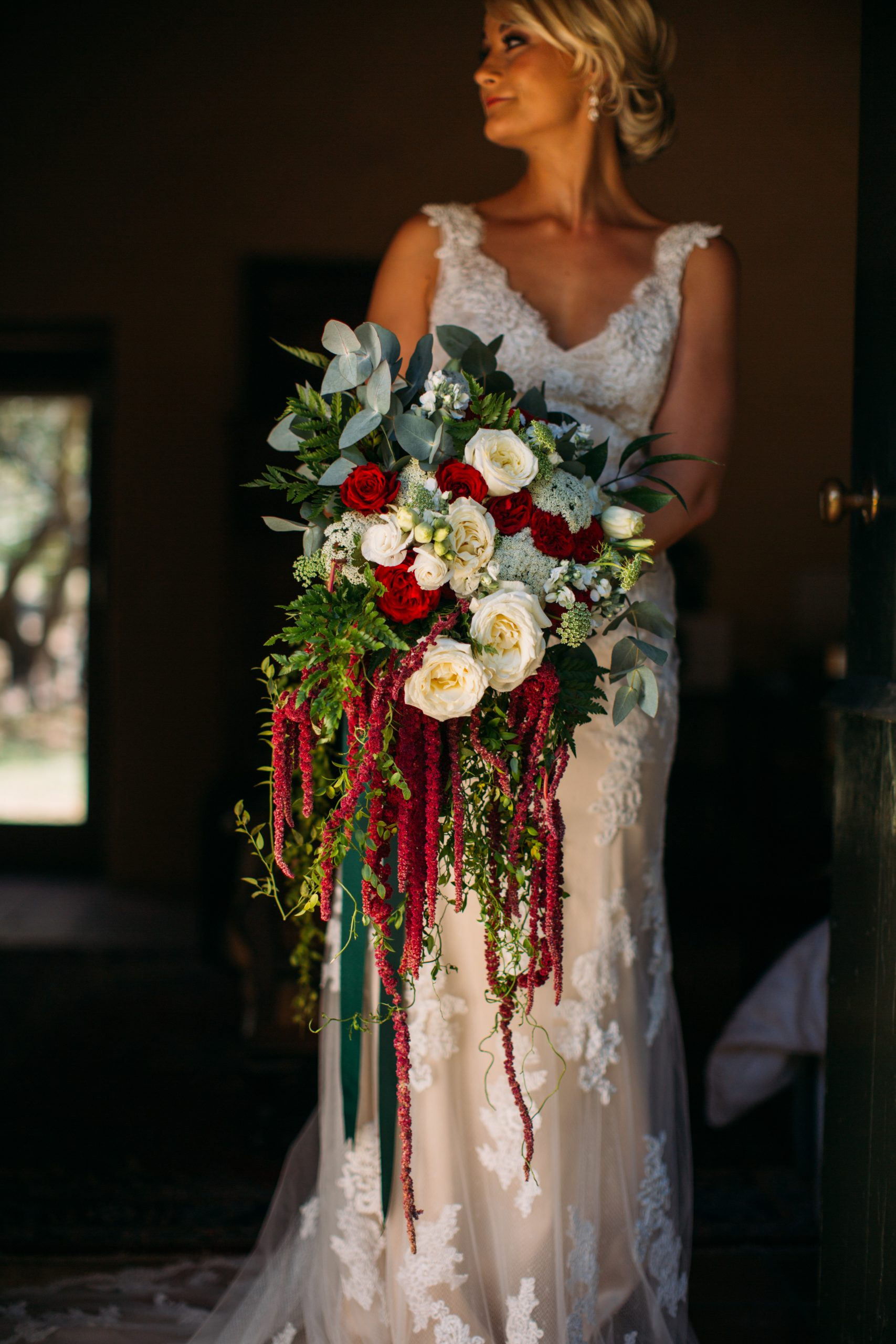 Bride Holding A Bouquet Of Flowers scaled