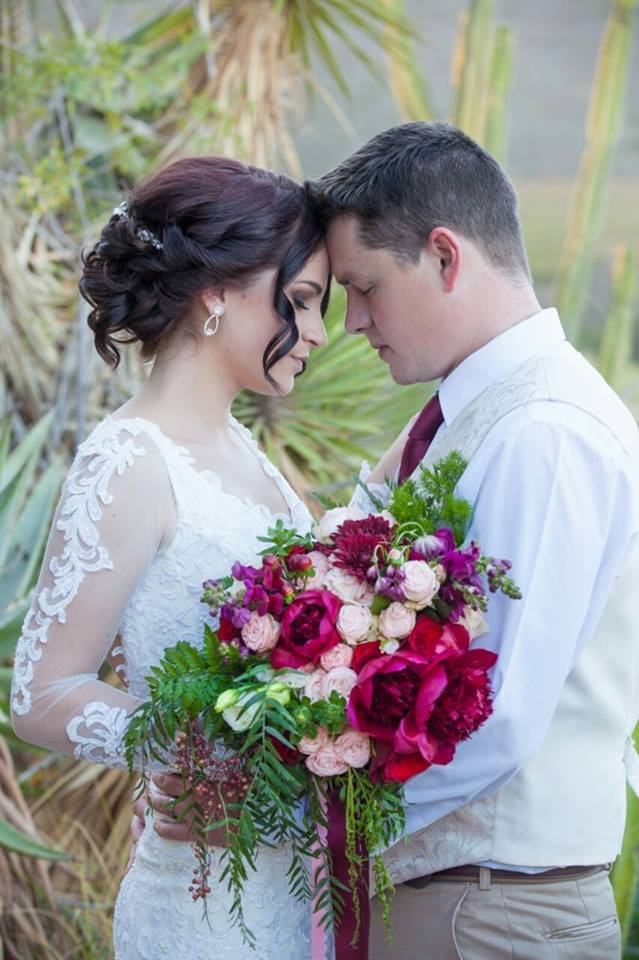 Bride and Groom Embrace Head to Head