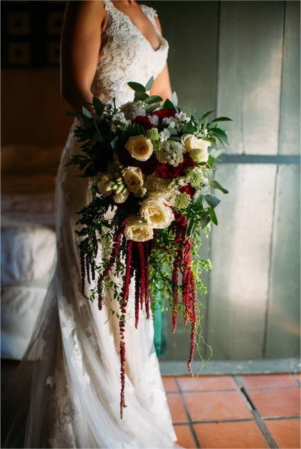 Close Up Of Wedding Dress And An Opulent Bouquet
