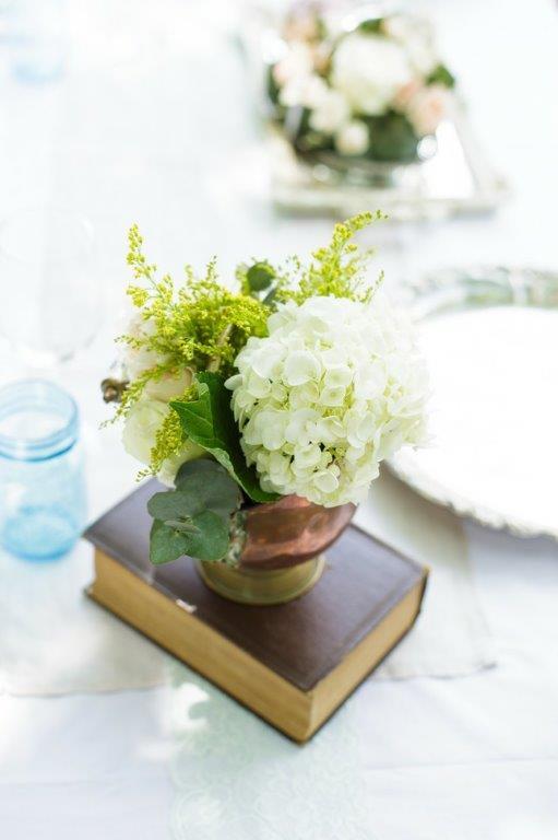 Hydrangea Arrangement Placed On Book