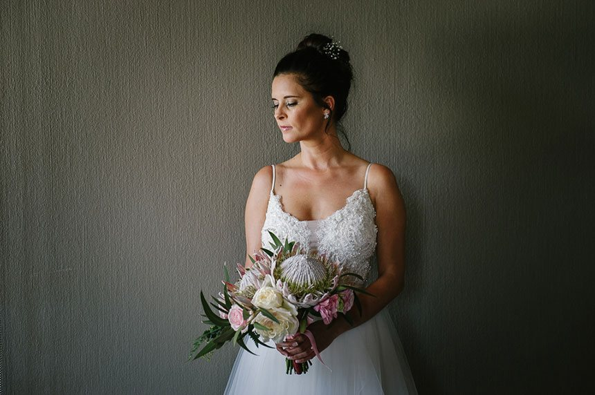 My Pretty Vintage Beautiful Bride Holding A Bouquet Of Flowers