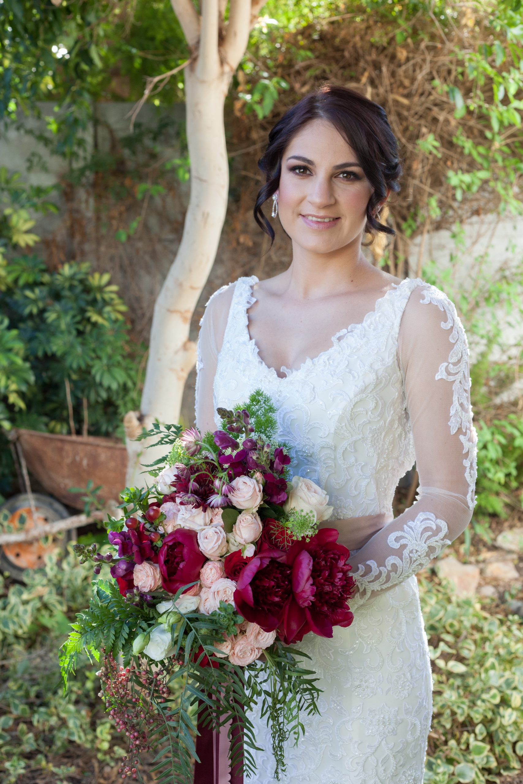 Veautiful Bride Holding Her Bridal Bouquet scaled