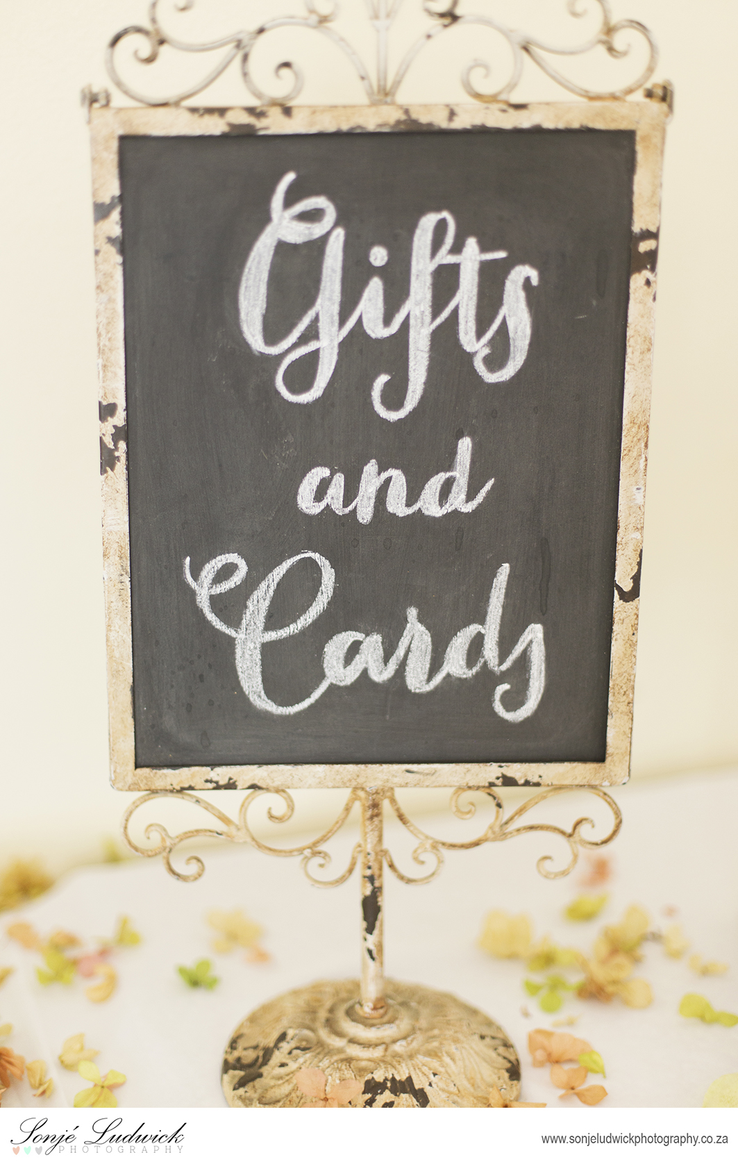 Vintage Black Board Displaying Gifts and Candy