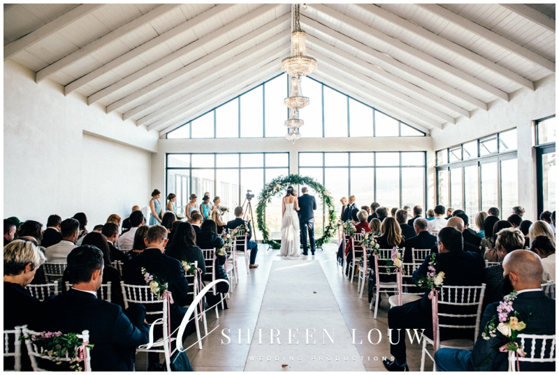 Wedding Ceremony With Giant Wreath Backdrop