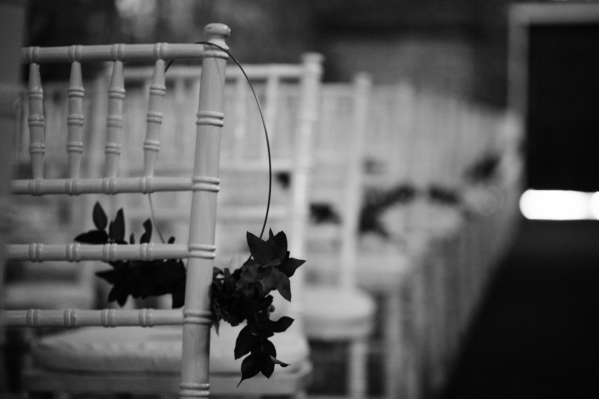 White Wooden Chairs At Wedding Venue
