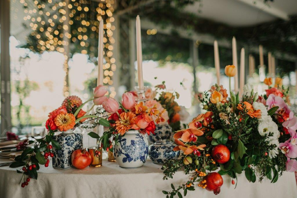 Wedding Centerpiece Dutch Delft Vases With Spicy, Fruity Pomegranates Coloured Orange Flowers Roses, Dahlia, Attractive Berries