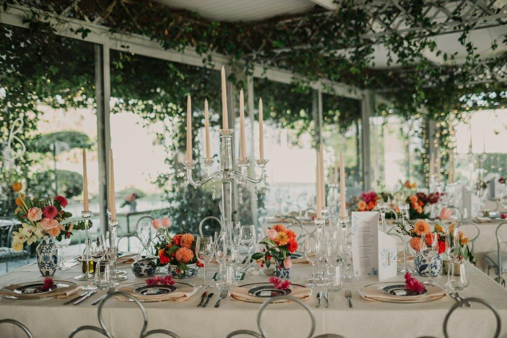 Candelabra Wedding Table Centerpieces Dutch Delft Vases With Spicy, Fruity Pomegranates Coloured Orange Flowers Roses, Dahlia, Attractive Berries