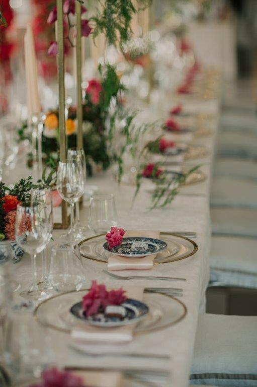 Candelabra Wedding Table Centerpieces Dutch Delft Vases With Spicy, Fruity Pomegranates Coloured Orange Flowers Roses, Dahlia, Pink BougainvilleaAttractive Berries