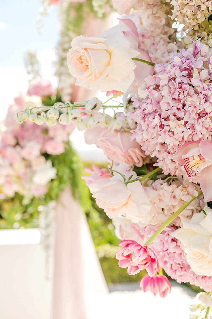Close up of Floral Arches Pastel Pinks Hydrangeas Orchids Roses Tulips Delphinium